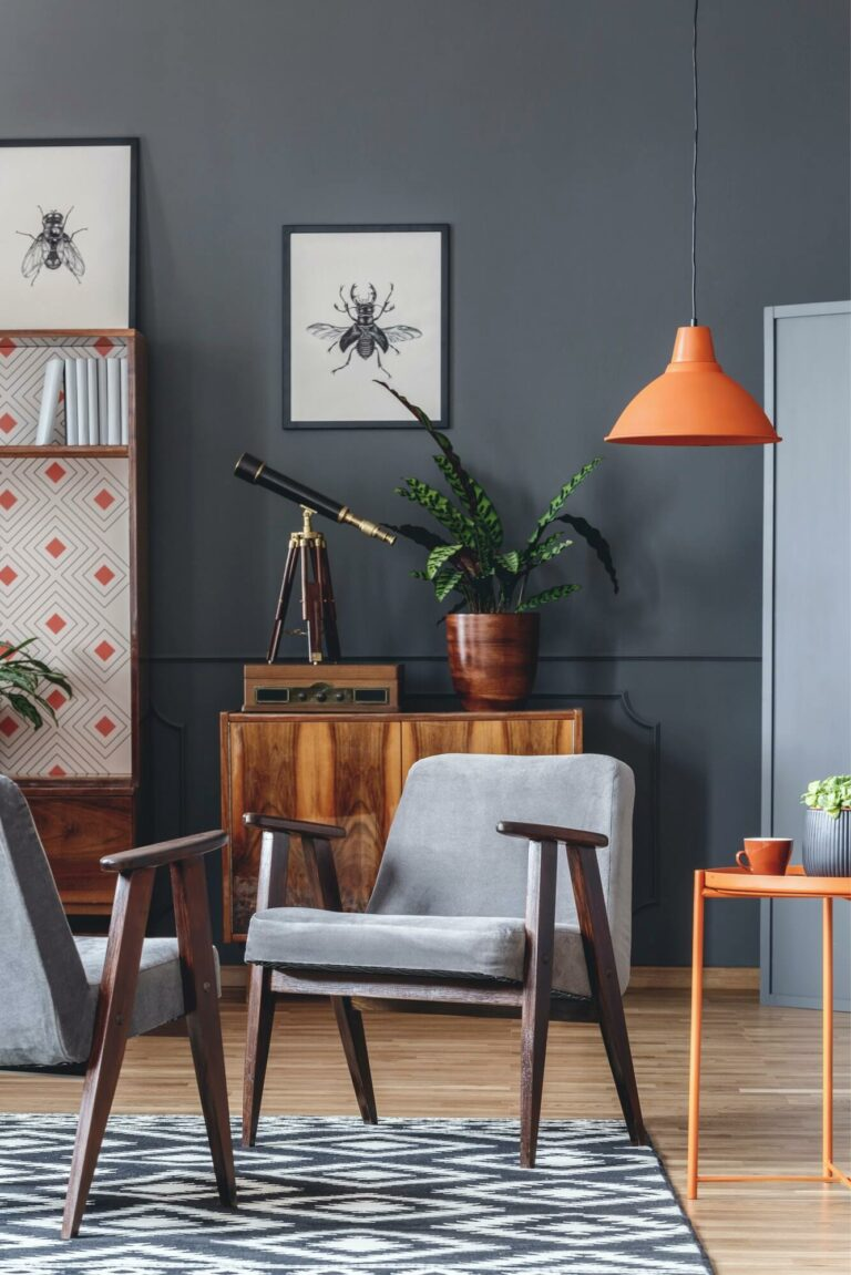 dark-living-room-interior-with-armchairs-orange-lamp-plant-and.jpg